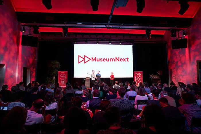 Photography of the speakers on the stage at a previous MuseumNext event