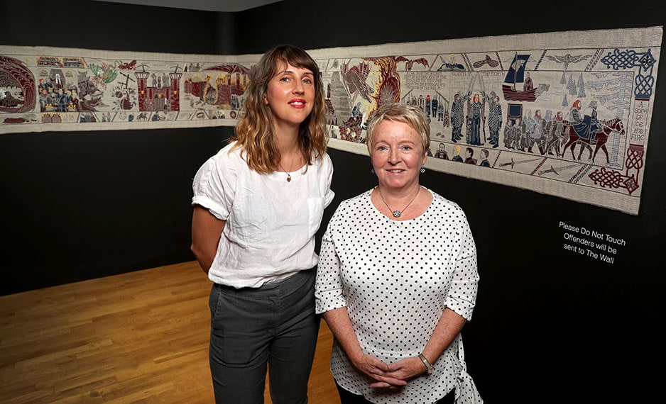 Sarah Dee, Tourism Ireland; and Valerie Wilson, Curator of Costume and Textiles at National Museums Northern Ireland, at Tourism Ireland's Game of Thrones Tapestry in the Ulster Museum