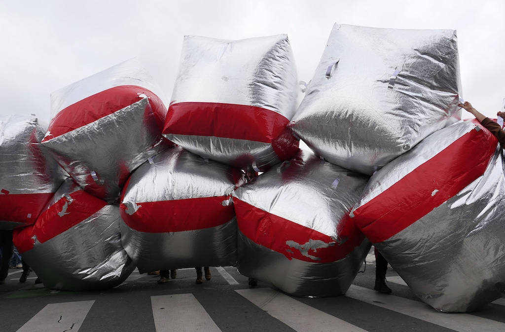 Inflatables block a road at the COP21 protest in Paris 2015