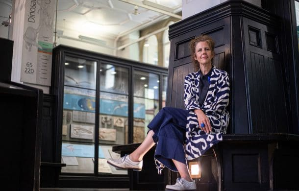 Esme Ward, Director of Manchester Museum sitting among the collections