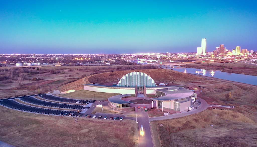 An aerial view of the First Americans Museum showing Oklahoma City in the background