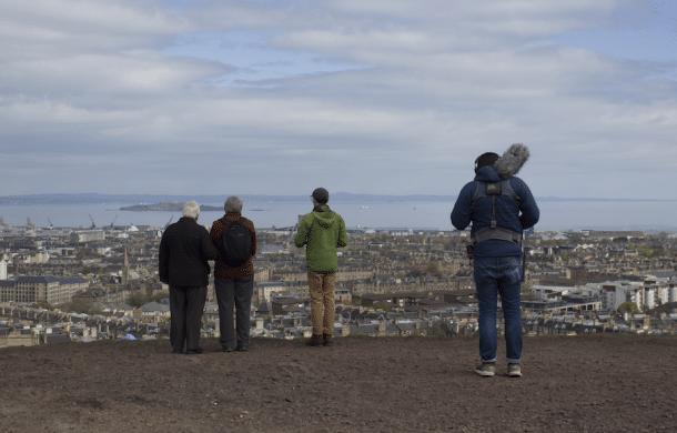 People listen to audio guides on Edinburgh's Carlton Hill